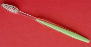 Sandwich-moulded toothbrush handle